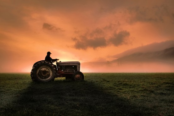 Farmer and tractor at Twilight