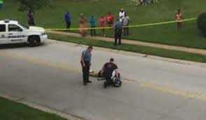 Michael Brown's body being examined by police